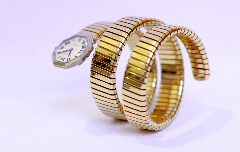 bulgari ladyu0027s yellow and white gold tubogas bracelet watch circa