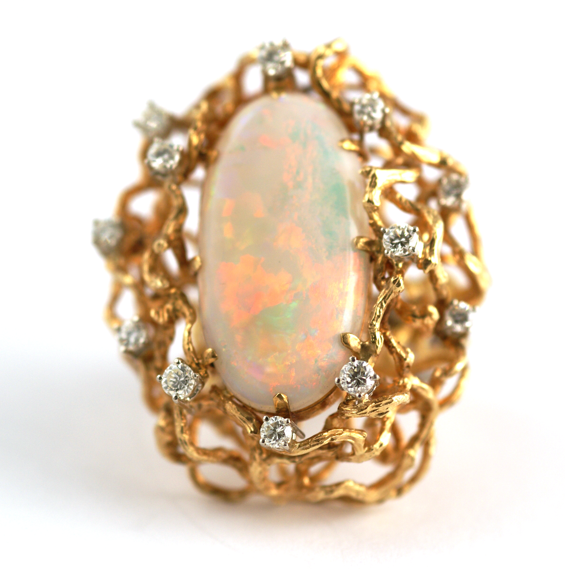 imposing opal and gold cocktail ring eleuteri